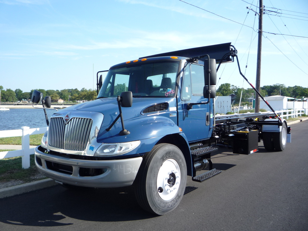 USED 2012 INTERNATIONAL 4300 ROLL-OFF TRUCK #11216