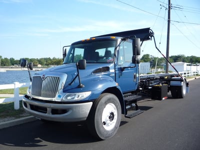 USED 2012 INTERNATIONAL 4300 ROLL-OFF TRUCK #11216-1