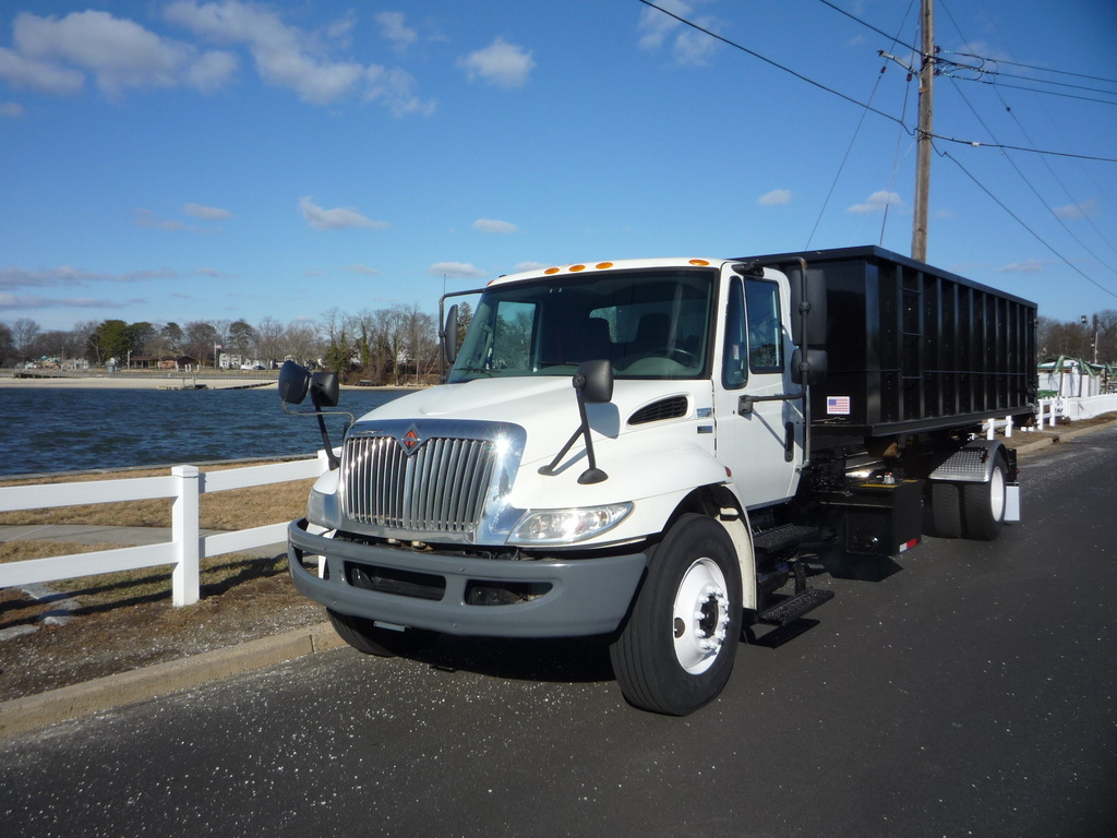 USED 2012 INTERNATIONAL 4300 ROLL-OFF TRUCK #11296