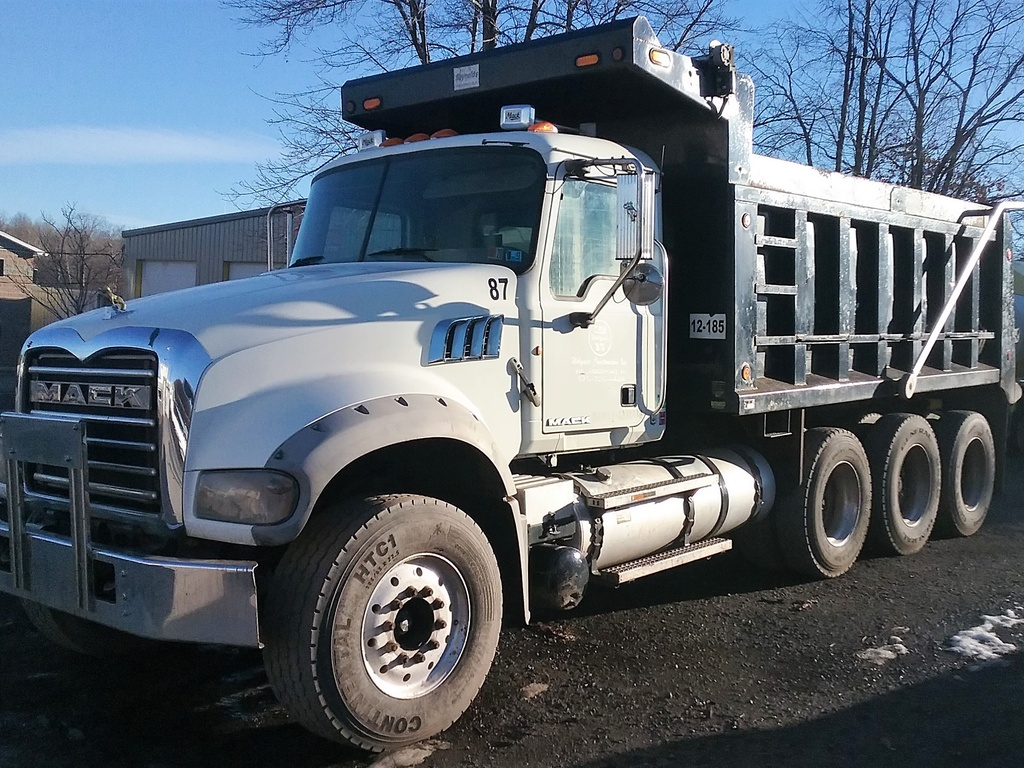 USED 2011 MACK GU - 713 TRI-AXLE STEEL DUMP TRUCK #1530